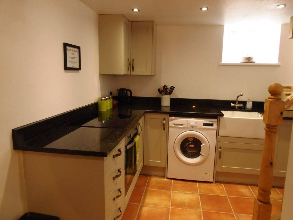 Well equipped kitchen with everything you need and gorgeous granite work surfaces.