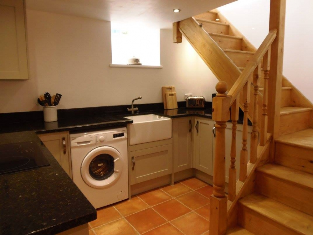 Stairs lead down to lovely kitchen and dining area and additional WC.